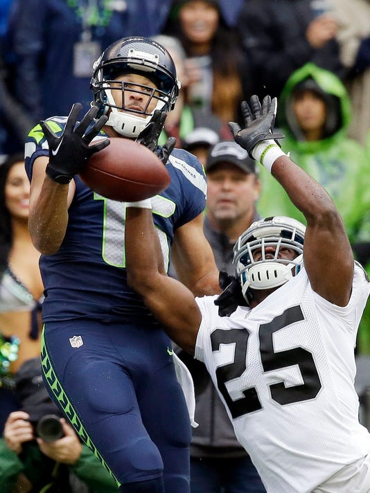 Oakland Raiders' D.J. Hayden (25) breaks up a pass to Seattle Seahawks' Jermaine Kearse, but was called for pass interference on the play in the first half of an NFL football game, Sunday, Nov. 2, 2014, in Seattle. (AP Photo/Elaine Thompson)