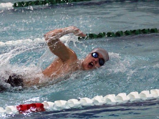 Shippensurg's Eli Zinn swims a freestyle race against James Buchanan in a Mid Penn Colonial Division meet. Shippensburg swept the Rockets 101-51 (boys) and 94-75 (girls).