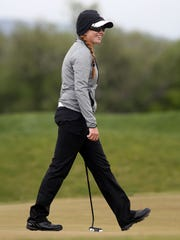 Desert Hills' Tori Thomas smiles after winning the
