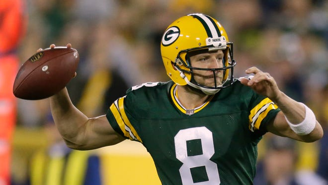 Green Bay Packers quarterback Taysom Hill (8) scrambles to throw a touchdown pass during the fourth quarter of their preseason game Thursday, August 31, 2017, at Lambeau Field.