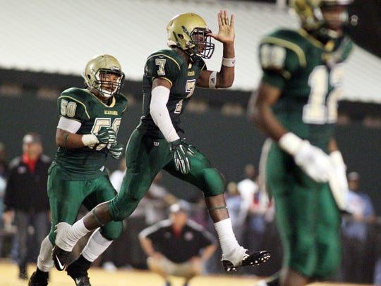 Acadiana's Kevin Moore (7) celebrates after intercepting