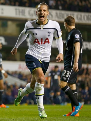 Tottenham's Roberto Soldado celebrates after scoring a goal that gave his team a 2-1 lead over Everton.