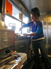 InfiniteBBQ co-owner Melissa Pearce works on Nov.16 inside her food truck in Farmington.