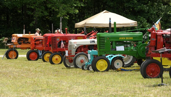 The First State Antique Tractor Club shows its members' antique pieces. Presidents of local Farm Bureau units say farmers work to protect the environment each day.