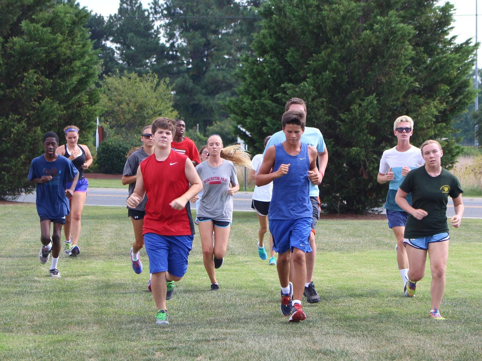 Worcester Prep's new cross country team jogs to warm up Tuesday, Aug. 25.