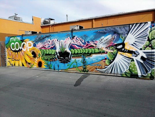 """""""Protect the Organ Mountains,"""" by Sebastian Velasquez and others, is on the exterior of Mountain View Market."""
