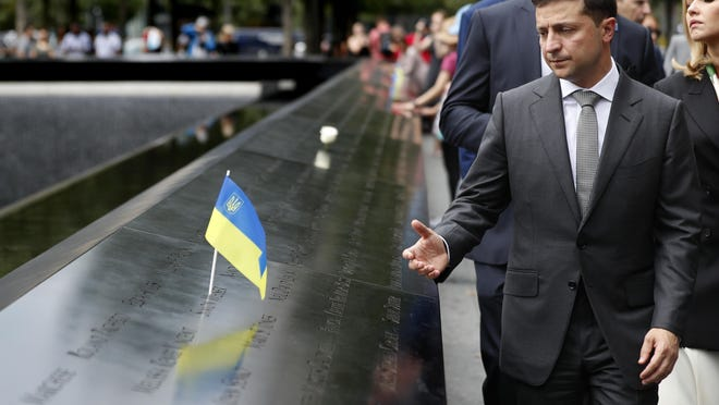NEW YORK -- Ukraine President Volodymyr Zelensky visits the site of the 9/11 terror attacks at ground zero in New York on last year. Zelensky made specific stops at the names of victims that were born in Ukraine.