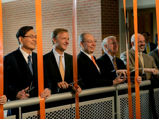 Dignitaries pose for a photo just before cutting the ribbons to dedicate the new $37.5 million Min H. Kao Electrical Engineering and Computer Science Building on March 14, 2012. From left are Fran and Min Kao, Gov. Bill Haslam, Chancellor Jimmy Cheek, Dean Wayne Davis and President Joe DiPietro.