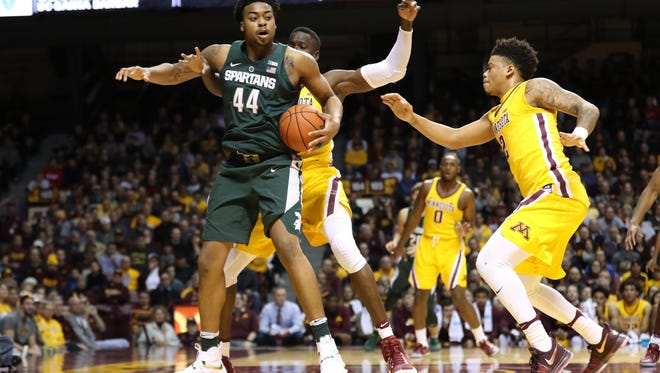 MSU's Nick Ward (44) looks to pass against Minnesota Golden Gophers center Bakary Konate (21) Tuesday night. Ward finished with 22 points, 10 rebounds and four blocks.