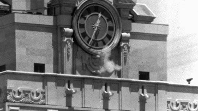 Smoke rises from the sniper's gun as he fired from the tower of the University of Texas administration building in Austin, Texas, Aug. 1, 1966.