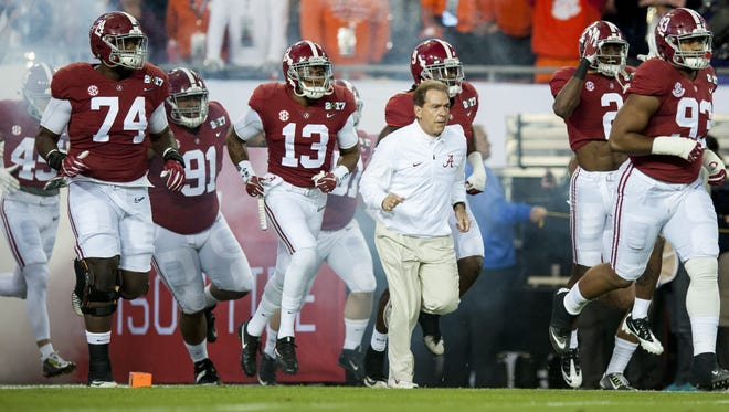 Alabama head coach Nick Saban takes the field against Clemson in first half action of the College Football Playoff National Championship Game at Raymond James Stadium in Tampa, Fla. on Monday January 9, 2017. (Mickey Welsh / Montgomery Advertiser)