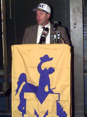 Tommy Tate, now the defensive coordinator at Opelousas Catholic, speaks during a news conference in 2000 after he was named football coach at McNeese State.