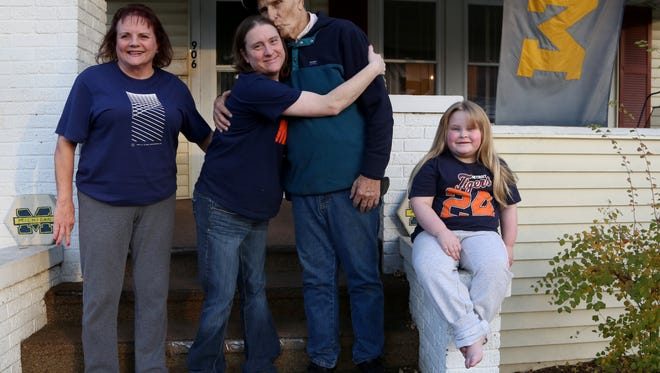 (L to R) Cecelia Flory, 62, her daughter Kasey Tuffy Hadd with her father David Flory, 78 and Hadd's daughter Carleigh Hadd, 5, on the steps leading up to the porch of her mother's home in Owosso, Michigan, on Friday, November 18, 2016. Hadd was born as a preemie on Christmas Eve 1979 weighing in at 15 oz at Sparrow Hospital in Lansing, Michigan. Even the clothes that the doll is wearing are the same clothes that were hand sewn for her to wear as a preemie. Her daughter Carleigh was also born early, three weeks early at the same hospital. Both have much to be thankful for and is celebrating the holiday with her family on Thursday. Eric Seals/Detroit Free Press