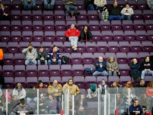 Fans sporadically fill the seats above the hockey benches March 15 to watch the Elmira Jackals take on the Wheeling Nailers inside First Arena.