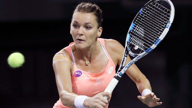 Agnieszka Radwanska, of Poland, returns a shot against Monica Puig, of Puerto Rico, during their quarterfinal match at the Pan Pacific Open.