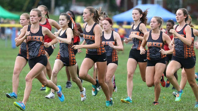 The Green girls are off and running in the big school division of the East Canton Cross Country Invitational on Sept. 2. Olivia Gang, far left, won the event.