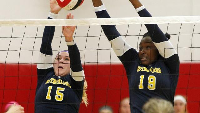 Junior setter Andrea Allen, who is nursing an ankle injury, and senior All-American hitter Santita Ebangwese, right, lead the Knights as they go after a second straight state title today in Glens Falls.