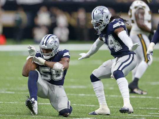 Dallas Cowboys defensive end Robert Quinn (58) and middle linebacker Jaylon Smith (54) celebrates Quinn's sack of New Orleans Saints quarterback Teddy Bridgewater in the second half at the Mercedes-Benz Superdome. Chuck Cook-USA TODAY Sports