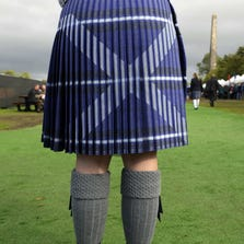 A woman wears a kilt with the Scottish flag on it in Glasgow on Aug. 16.