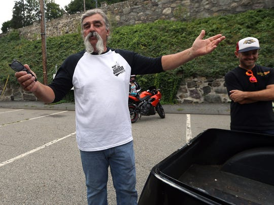 Mike 'The Junkman' Anest of Boonton talks to fellow bikers about his 1971 Harley Davidson service car during the monthly themed 'First Friday' Biker Night event in downtown Boonton. August 5, 2016, Boonton, NJ
