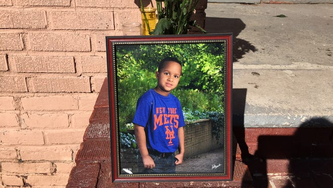 The memorial for 9-year-old Dariel Sosa in front of his Brighton Avenue home in Perth Amboy.