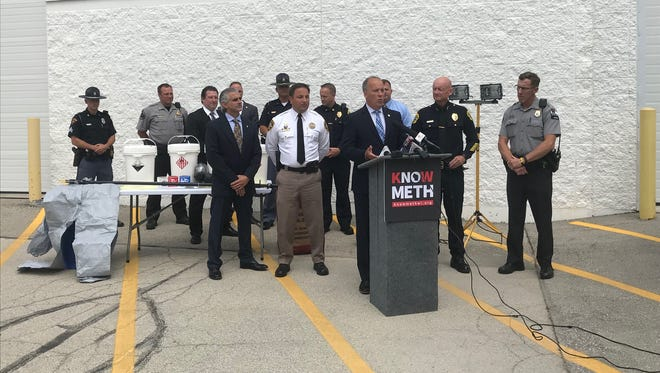 Attorney General Brad Schimel (center) announced the six methamphetamine chemical storage containers would be placed around the state to aid law enforcement in cleaning up meth labs and waste.