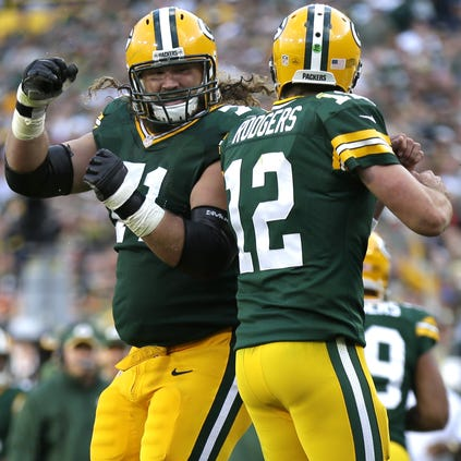 Green Bay Packers' Josh Sitton and Aaron Rodgers celebrate a third quarter touchdown.