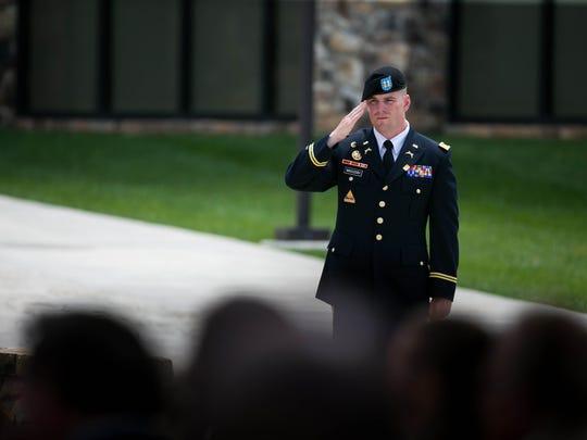 Capt. Dan MacLeish salutes during the National Anthem.