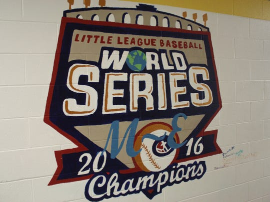 A mural painted by Maine-Endwell central school district art students at Maine-Endwell Middle School honors the M-E Little League Baseball World Series champions.