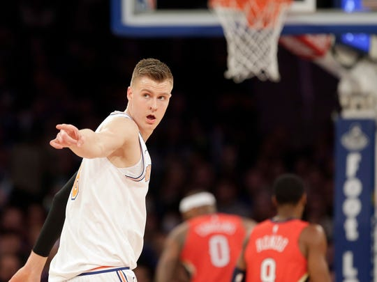 New York Knicks' Kristaps Porzingis reacts after scoring during the first half of an NBA basketball game against the New Orleans Pelicans, Sunday, Jan. 14, 2018, in New York.
