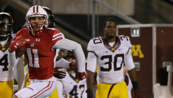 Wisconsin wide receiver Jazz Peavy (11) streaks 71 yards down the sideline in the fourth quarter of the Badgers victory over Minnesota on Saturday at Camp Randall Stadium.