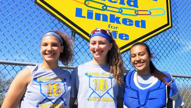 Shortstop Bridgette Gilliano, left, pitcher Natalie Ampole, center, and catcher Reyna Torres are the sophomores that help drive Buena's softball team.