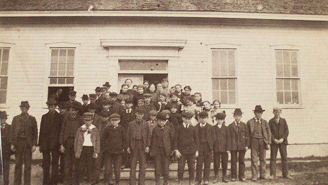 Mishicot students take a break from class to line up outside Mishicot's second school building - now home to the Mishicot Historical Museum - in this photo taken prior to 1905.