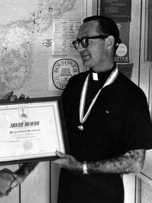 The Rev. Louis Brouillard receives the Boy Scouts of America's Silver Beaver Award for his work as a troop leader in this undated photo.