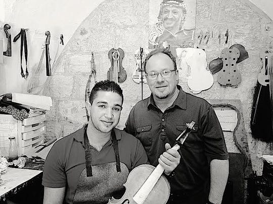 Michael Dabroski (right), shown with Palestinian luthier