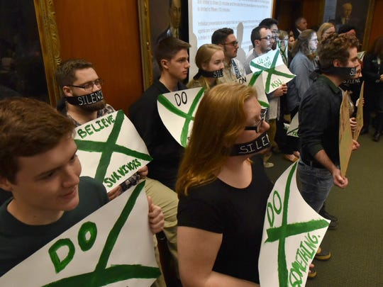 Demonstrators at the MSU trustees meeting Friday morning