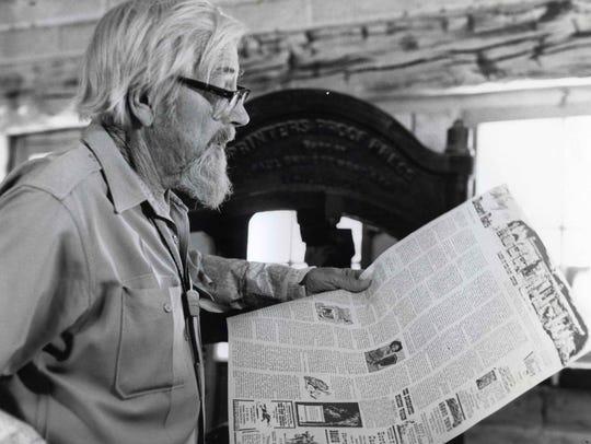 Harry Oliver reading the Desert Rat newspaper.