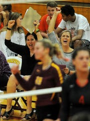 Roosevelt's head volleyball coach Holly Lynch after scoring a point against Washington at Roosevelt High School on Thursday, September 3, 2015.