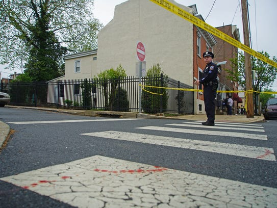 A Wilmington Police officer stands inside the crime
