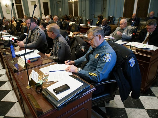 Camden Police Chief William Byrson, reviews the HB110
