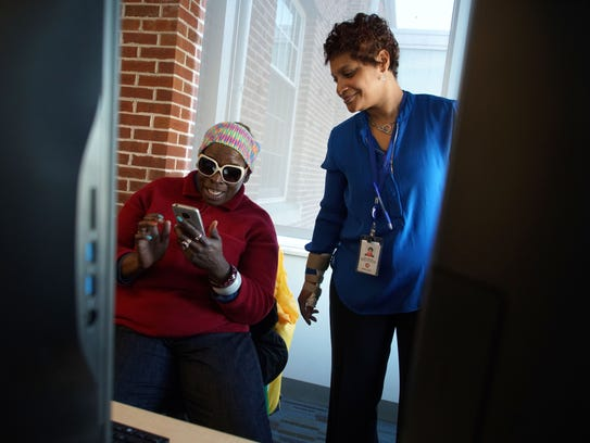 From left, Tanja Baines, who lives in a shelter, gets help from Dorian Baker, a social worker for Delaware Health and Social Services, on finding housing through the State Rental Assistance Program, while visiting the Dover Library.