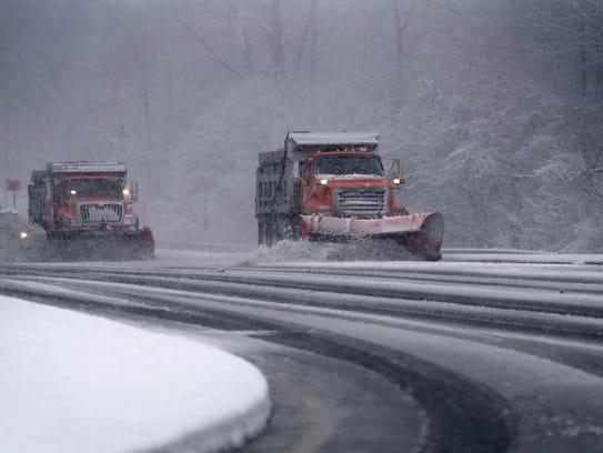 DelDOT plow trucks remove falling snow from Lancaster