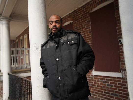 Eric Mundy stands in front of the property at 103 Oak St. where he worked as a trainee in the Interfaith Community Housing of Delaware's HomeWorks program, a pre-apprenticeship program for construction training. He said he felt he was in danger at the property because of the disrepair.