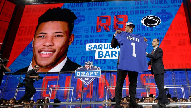 Penn State's Saquon Barkley poses after being selected by the New York Giants with the No. 2 pick of the NFL Draft.