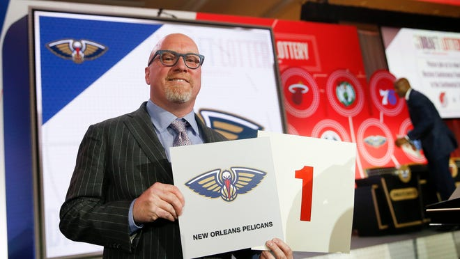 David Griffin, New Orleans Pelicans executive vice president of basketball operations, holds up placards after it was announced that the Pelicans had won the first pick during the NBA basketball draft lottery Tuesday, May 14, 2019, in Chicago. (AP Photo/Nuccio DiNuzzo) ORG XMIT: ILND110