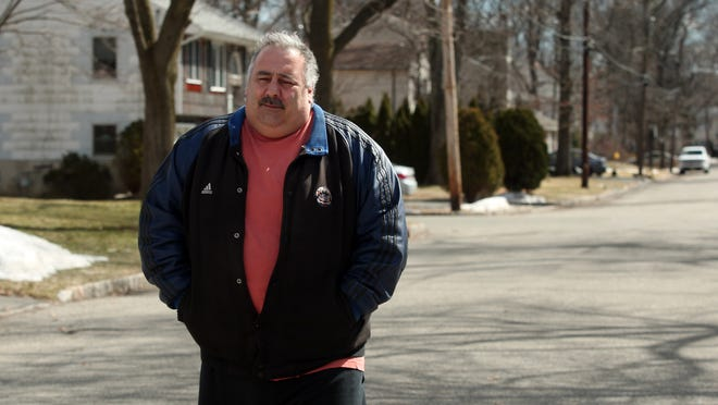 Rob Miscia, a 49-year-old DPW worker who was diagnosed last year with cancer, walks his neighborhood during his recovery.