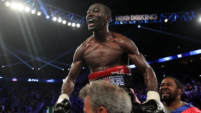 WBO Lightweight champion Terence Crawford knocks out  Yuriorkis Gamboa in the 9th round  Saturday in Omaha.