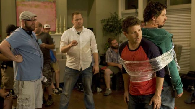 """Sean Astin and Kevin Downes (in the green sweatshirt) shoot a scene during the production of """"Moms' Night Out."""" Directors Andrew and Jonathan Erwin are in the background."""