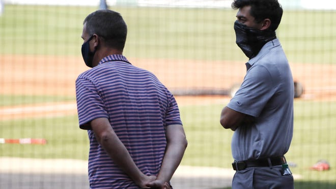 Boston Red Sox president Sam Kennedy, left, and chief baseball officer Chaim Bloom watch batting practice prior to a game Monday, July 27, at Fenway Park.