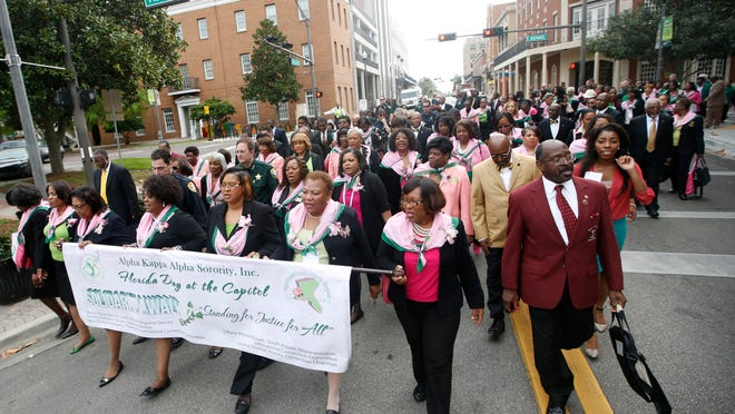 Alpha Kappa Alpha Sorority sisters lead the way during the State of Black Friday Solidarity Walk downtown on Thursday.